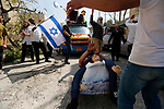Israeli settlers celebrate the Jewish holiday of Purim, in the West Bank city of Hebron, on March 21, 2019. Purim is a celebration of the Jews' salvation from genocide in c, as recounted in the Book of Esther. Photo by Wisam Hashlamoun