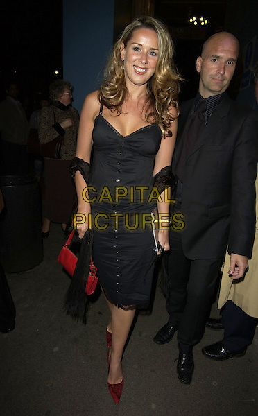 "CLAIRE SWEENEY.""Hay Fever"" gala evening at Theatre Royal Haymarket, London, UK..April 25th 2006 .Ref: CAN.full length black dress buttons red shoes purse bag.www.capitalpictures.com.sales@capitalpictures.com.©Capital Pictures"