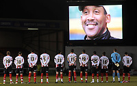 The Lincoln City players observe a moments silence in memory of former-Imps manager Keith Alexander who died last week, aged 53<br />