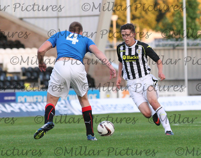 Jordan Stewart running at Greg Pascazio in the St Mirren v Rangers Scottish Professional Football League Under 20 match played at St Mirren Park, Paisley on 10.9.13.