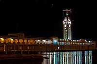 Aloha Tower at night w/ lights reflecting off the water in Honolulu, Oahu, Hawaii