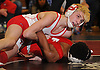 Jared Altan of Plainedge, top, controls Khaleem Morris of Freeport at 99 pounds during the final round of the 2016 Ted Petersen Tournament at Island Trees High School on Saturday, Jan. 2, 2016. Altan won the match.