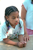 Pensive girl age 6 deep in thought.  St Paul  Minnesota USA