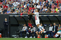 CLEVELAND, OHIO - JUNE 22: Cordell Cato #7, Nick Lima #2 during a 2019 CONCACAF Gold Cup group D match between the United States and Trinidad & Tobago at FirstEnergy Stadium on June 22, 2019 in Cleveland, Ohio.