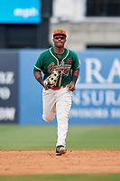 Greensboro Grasshoppers right fielder Isael Soto (15) jogs back to the dugout in between innings during a game against the Lakewood BlueClaws on June 10, 2018 at First National Bank Field in Greensboro, North Carolina.  Lakewood defeated Greensboro 2-0.  (Mike Janes/Four Seam Images)