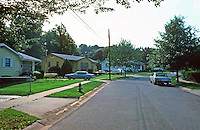 Greenbelt:  Standard Post-War World II single family houses--wider streets, sidewalks, tree-lined streets, front lawns.  Photo '85.