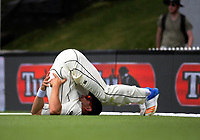 NZ's Neil Wagner stretches during day four of the international cricket test between the NZ Black Caps and the West Indies at the Hawkins Basin Reserve in Wellington, New Zealand on Monday, 4 December 2017. Photo: Dave Lintott / lintottphoto.co.nz