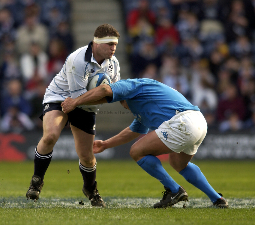 .Photo. Jed Wee.Scotland v Italy, RBS Six Nations Championship, Murrayfield, Scotland. 29/03/2003..Scotland's Bruce Douglas (L).