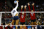 KANSAS CITY, KS - DECEMBER 14:Jazz Sweet #12 and Briana Holman #13 of the University of Nebraska jump for a block against Simone Lee #22 of Penn State University during the Division I Women's Volleyball Semifinals held at Sprint Center on December 14, 2017 in Kansas City, Missouri. (Photo by Tim Nwachukwu/NCAA Photos via Getty Images)