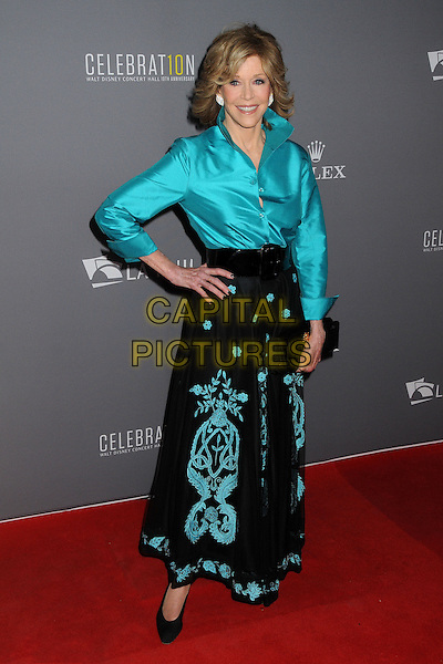 Jane Fonda<br /> LA Philharmonic's Walt Disney Concert Hall 10th Anniversary Celebration held at the Walt Disney Concert Hall, Los Angeles, California, USA.<br /> September 30th, 2013<br /> full length black pattern skirt hand on hip blue green turquoise silk satin blouse<br /> CAP/ADM/BP<br /> &copy;Byron Purvis/AdMedia/Capital Pictures