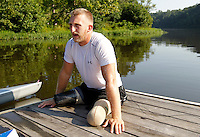 Former Marine sergeant Rob Jones rests on the dock after an intensive rowing workout Wednesday July, 25, 2012 on the Rivanna River in Charlottesville, VA. Former Marine sergeant Jones, who lost both legs during an IED explosion in Afghanistan, will compete as a rower at the 2012 Paralympics in London, England. Rowing will make its appearance at the London Paralympic Games for only the second time, after its introduction at the Beijing 2008 Games. Photo/Andrew Shurtleff