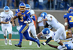 BROOKINGS, SD - SEPTEMBER 10:  Taryn Christion #3 from South Dakota State scampers past the defense of Drake during their game at the Dana J. Dykhouse Stadium Saturday night in Brookings. (Photo by Dave Eggen/Inertia)