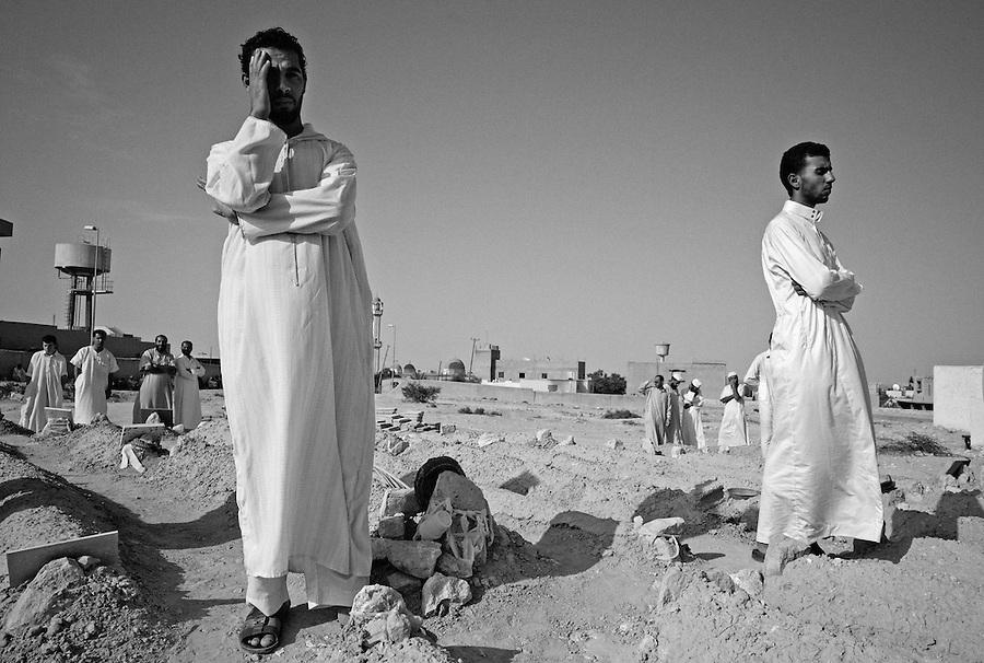 Libyan men mourn during funeral ceremony in Zintan, Libya