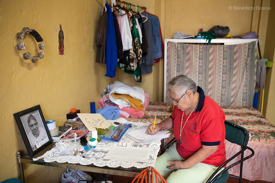 Elia, a resident of Casa Xochiquetzal, studies mathematics in her bedroom at the shelter in Mexico City, Mexico on June 8, 2016. Casa Xochiquetzal is a shelter for elderly sex workers in Mexico City. It gives the women refuge, food, health services, a space to learn about their human rights and courses to help them rediscover their self-confidence and deal with traumatic aspects of their lives. Casa Xochiquetzal provides a space to age with dignity for a group of vulnerable women who are often invisible to society at large. It is the only such shelter existing in Latin America. Photo by Bénédicte Desrus
