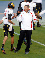 Maryland Terrapins head coach Randy Edsall celebartes with players during the game against Virginia in Charlottesville, Va. Maryland defeated Virginia 27-20.