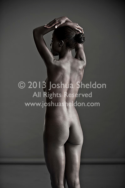Rear view of nude African American woman standing