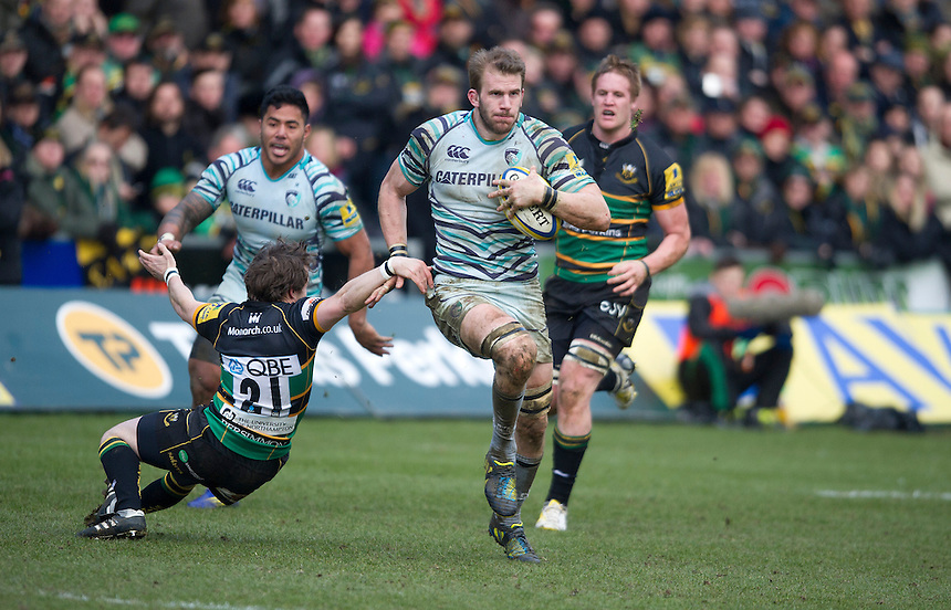 Leicester Tigers' Tom Croft avoids the challenge from Northampton Saints' Martin Roberts ..Rugby Union - Aviva Premiership - Northampton Saints v Leicester Tigers - Saturday 30th March 2013 - Franklin's Gardens - Northampton..© CameraSport - 43 Linden Ave. Countesthorpe. Leicester. England. LE8 5PG - Tel: +44 (0) 116 277 4147 - admin@camerasport.com - www.camerasport.com..