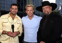 Montgomery Gentry w/ Greg Martain of CMT at the first ever CMT Flameworthy Video Music Awards at the Gaylord Entertainment Center in Nashville Tennesee. 6/12/02<br /> Photo by Rick Diamond/PictureGroup