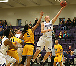 SIOUX FALLS, SD - DECEMBER 7: Chase Grinde #14 from the University of Sioux Falls takes the ball to the basket past Lee Higgins #5 from Concordia St. Paul during their game Friday night at the Stewart Center in Sioux Falls, SD. (Photo by Dave Eggen/Inertia)