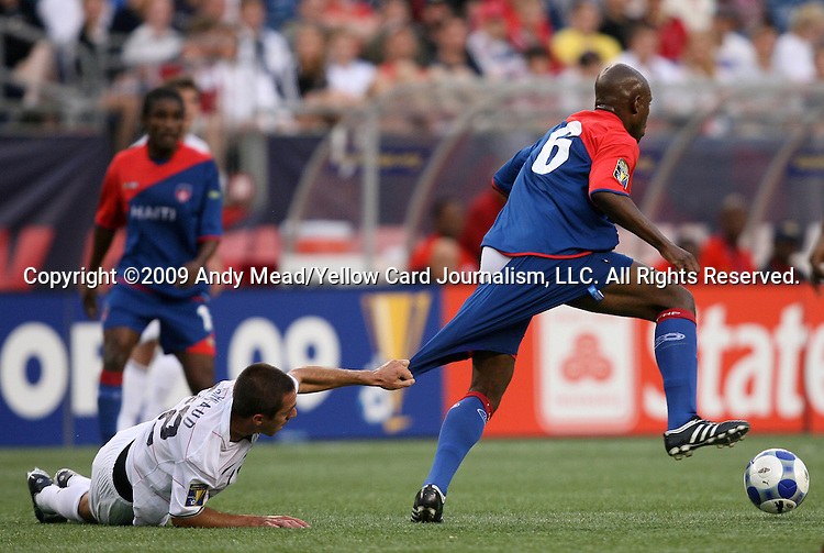 11 July 2009: Davy Arnaud (USA) (22) grabs the shorts of Frantz Bertin (HAI) (6). The United States Men's National Team played the Haiti Men's National Team at Gillette Stadium in Foxboro, Massachusetts in a 2009 CONCACAF Gold Cup first round game.