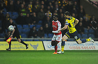 Fleetwood Town's Jordy Hiwula under pressure from Oxford United's John Mousinho<br /> <br /> Photographer Kevin Barnes/CameraSport<br /> <br /> The EFL Sky Bet League One - Oxford United v Fleetwood Town - Tuesday 10th April 2018 - Kassam Stadium - Oxford<br /> <br /> World Copyright &copy; 2018 CameraSport. All rights reserved. 43 Linden Ave. Countesthorpe. Leicester. England. LE8 5PG - Tel: +44 (0) 116 277 4147 - admin@camerasport.com - www.camerasport.com