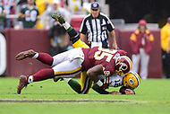 Landover, MD - September 23, 2018: Washington Redskins defensive tackle Da'Ron Payne (95) sacks Green Bay Packers quarterback Aaron Rodgers (12) during game between the Green Bay Packers and the Washington Redskins at FedEx Field in Landover, MD. The Redskins get the win 31-17 over the visiting Packers. (Photo by Phillip Peters/Media Images International)