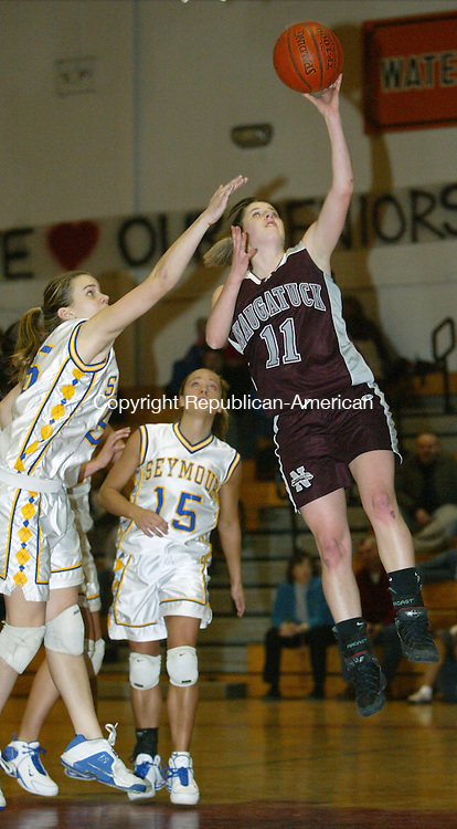 TORRINGTON, CT, 02/19/07- 021907BZ23- Naugatuck's Julie Piroscafo (11) goes to the hoop against Seymour's Sarah Stevens (54) <br />  during in the NVL tournament at Torrington High School Monday.<br /> Jamison C. Bazinet Republican-American