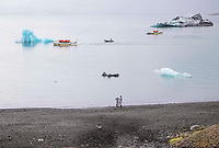 Glacial Icebergs and Tourist Boats in Jokulsarlon Lagoon