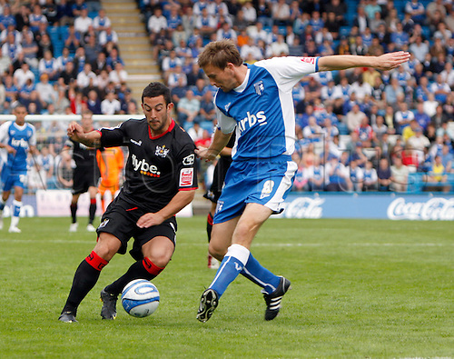 5th September 2009. Exeter City forward Stuart Fleetwood cuts inside Mark Bentley (8) during the second half. Division 1 match - Gillingham v Exeter City at Priestfield Stadium, Gillingham, Kent, England.Photo: Colin Read/Actionplus.
