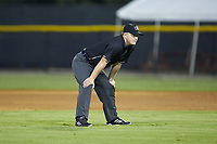 Umpire Zachary Robbins handles the calls on the bases during the Appalachian League game between the Kingsport Mets and the Burlington Royals at Burlington Athletic Stadium on July 27, 2018 in Burlington, North Carolina. The Mets defeated the Royals 8-0.  (Brian Westerholt/Four Seam Images)