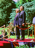 United States President George H.W. Bush, right, hosts President Mikhail Gorbachev of the Union of Soviet Socialist Republics, left, during a state arrival ceremony on the South Lawn of the White House in Washington, DC on Thursday, May 31, 1990.  It was the start of three days of talks between the two leaders.<br /> Credit: Howard L. Sachs / CNP