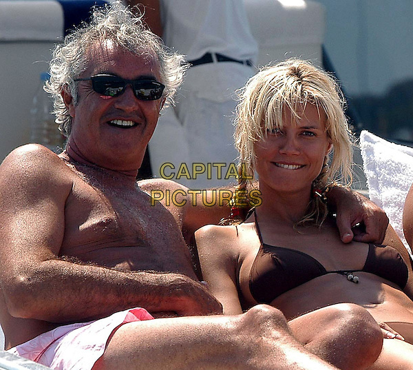 Flavio Briatore & Heidi Klum .On holiday, Costa Smeralda, Sardinia , Italy..July 11th, 2003.half length couple vacation holiday sun sunglasses shades brown bikini braid plait  .CAP/PPG.©People Picture/Capital Pictures