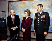 Former Prime Minister of the United Kingdom Margaret Thatcher, center, visited with Secretary of Defense Dick Cheney, left, and Chairman of the Joint Chiefs of Staff United States Army General Colin Powell, right, at the Pentagon on Thursday, March 7, 1991.  Among other topics of discussion was the success experienced by coalition forces, including air, land, and naval forces of both the United States and the United Kingdom, in securing the liberation of Kuwait during the recent Persian Gulf War.  Thatcher died from a stroke at 87 on Monday, April 8, 2013..Credit: Robert D. Ward - DoD via CNP