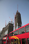 Bishopsgate Tower under construction from Shoreditch High Street, London, England with red double decker bus, April 2007
