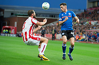 Ian Henderson of Rochdale heads the ball past Erik Pieters of Stoke City during the Carabao Cup match between Stoke City and Rochdale at the Britannia Stadium, Stoke-on-Trent, England on 23 August 2017. Photo by James Williamson / PRiME Media Images.