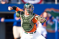 May 30, 2009:  NCAA Division 1 Gainesville Regional:    Miami Catcher (24) Yasmani Grandal  during 2nd round regional action at Alfred A. McKethan Stadium on the campus of University of Florida in Gainesville. Host University of Florida Gators defeated Miami Hurricanes  8-2 to advance in the Winners bracket.............