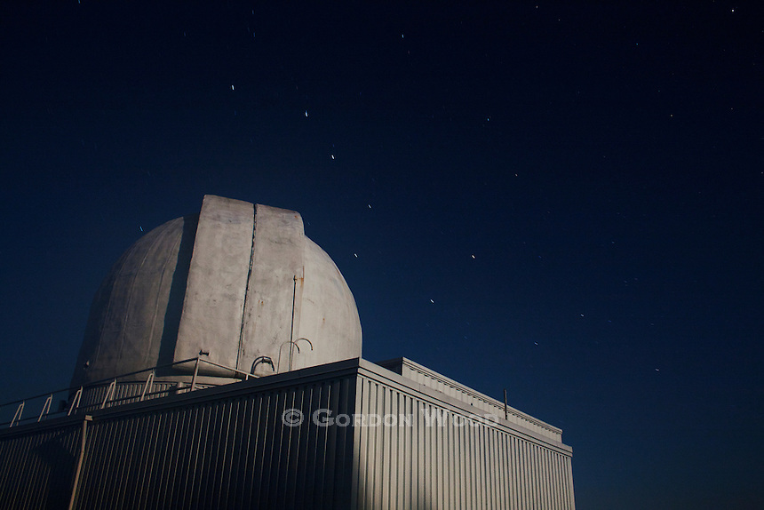 Observatory Illuminated by Moonlight with Star Trails