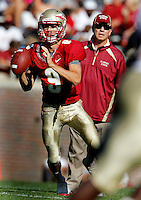 TALLAHASSEE, FLA. 4/16/11-FSUG&G041611 CH-Garnet quarterback Clint Trickett looks for a receiver as Head Coach Jimbo Fisher watches during second half action of the Florida State University Garnet and Gold game Saturday in Tallahassee. Garnet beat Gold 19-17..COLIN HACKLEY PHOTO