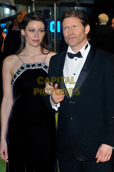 CRISPIN GLOVER & wife .Royal World Film Premiere of 'Alice in Wonderland' at the Odeon cinema, Leicester Square, London, England, UK,.25th February 2010.arrivals half length black dress tuxedo tux bow tie couple silver diamante sparkly trim .CAP/PL.©Phil Loftus/Capital Pictures