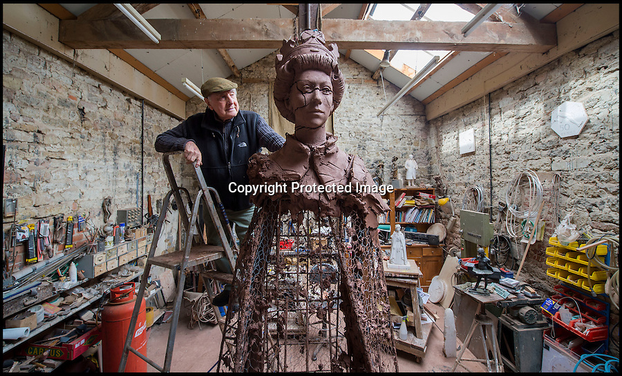 BNPS.co.uk (01202 558833)<br /> Pic: PhilYeomans/BNPS<br /> <br /> Larger than life - Artist James Butler in his Oxfordshire studio with the remains of his clay sculpture of the Queen from which the bronze cast was made.<br /> <br /> A huge statue of Queen Elizabeth II is being finished off at Lockbund Foundry near Banbury in Oxfordshire - before its unveiling at Runnymede to celebrate the 800th anniversary of Magna Carta.<br /> <br /> At over twice life size the imposing bronze sculpture by James Butler will dominate the historic meadow where the divine right of Kings was first checked.<br /> <br /> It shows the Queen in full Garter Robes and has been inspired by the 1954 portraits by Pietro Annigoni. The 4m (13ft) bronze sculpture will be unveiled on 14 June.