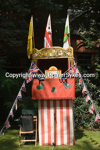 Punch and Judy show waiting to start. Next show at 3.30. Petersham village fete  Richmond Surrey Uk.