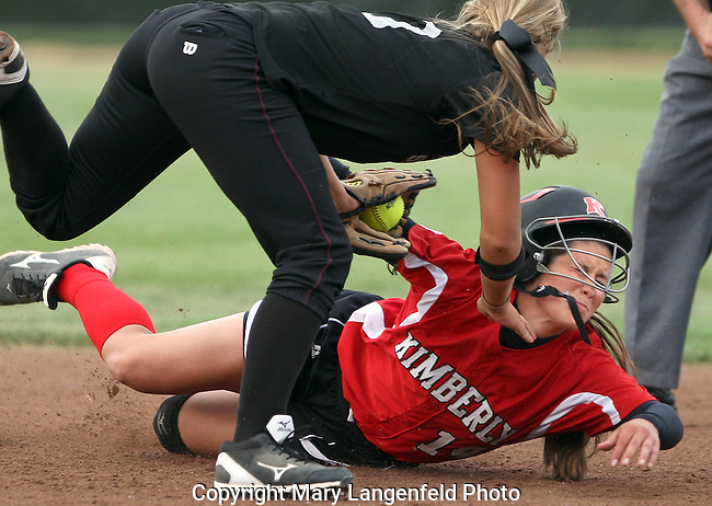 Kimberly's Jenny Smarzinski collides with Westosha Central's Julia Jester as she attempted to steal second base during the WIAA D-1 Championship Softball Tournament at Goodman Diamond in Madison. Kimberly defeated Westosha Central 6-5 in 15 innings for the D-1 state championship.