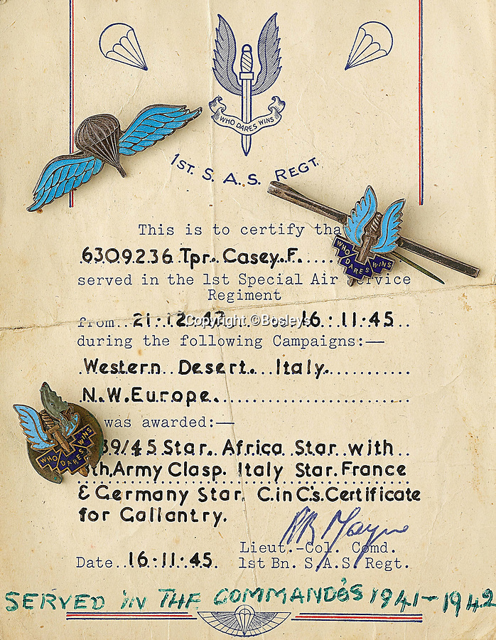 BNPS.co.uk (01202 558833)<br /> Pic: Bosleys/BNPS<br /> <br /> Fred Casey's war record, signed by SAS chief Paddy Mayne.<br /> <br /> Sold for £25,000 - An extraordinary wartime archive that lift's the veil on the earliest days of the SAS during WW2.<br /> <br /> The late Fred Casey was among the original dozen members of the 1st Special Air Service that was formed in North Africa to wreak havoc behind enemy lines.<br /> <br /> The commando's military possessions included a remarkable album containing previously unseen images of the founding members of the elite force.<br /> <br /> Legendary Captain David Stirling, who formed the 'Who Dares Wins' regiment, and hand-picked the men under his command, is pictured along with his controversial deputy Paddy Mayne , who took over the top secret regiment after Stirling's capture.<br /> <br /> The album sold at Bosley's Auctioneers of Marlow, Bucks, last week for over five times its pre-sale estimate..