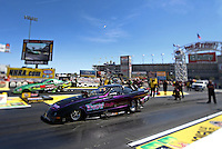 Apr. 5, 2013; Las Vegas, NV, USA: (Editors note: Special effects lens used in creation of this image) NHRA top alcohol funny car driver Annie Whiteley (near lane) during qualifying for the Summitracing.com Nationals at the Strip at Las Vegas Motor Speedway. Mandatory Credit: Mark J. Rebilas-