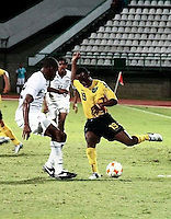 Dever Orgill (19) kicks the ball against Gale Agbossoumonde (22) US Under-20 Men's National Team defeated Jamaica 3-0 at Dwight Yorke Stadium in Bacolet, Tobago on March 6, 2009. Photo by Clement Williams/ isiphotos.com