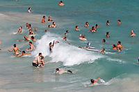 Spain, Mallorca, Parc Natural de Mondrago: S'Amarador beach with bathers riding waves | Spanien, Mallorca, Parc Natural de Mondrago: Badespass mit hohen Wellen am  S'Amarador Beach