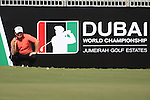 Graeme McDowell eyeing up his putt on the 18th during The second round of the Dubai World Championship on the Earth Course at the Jumeirah Golf Estate, Dubai..Picture Fran Caffrey/www.golffile.ie.