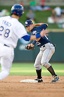 New Orleans Zephyrs second baseman Jesus Merchan #13 turns a double play during the game against the Round Rock Express at the Dell Diamond on July 21, 2011 in Round Rock, Texas.  New Orleans defeated Round Rock 7-4.  (Andrew Woolley/Four Seam Images)