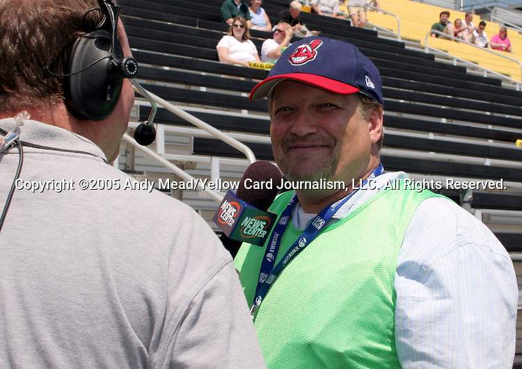30 July 2005: Comedian turned sports photographer Drew Carey entertains a local TV news crew. Major League Soccer's All-Stars defeated Fulham FC of the English Premier League 4-1 at Columbus Crew Stadium in Columbus, Ohio in the 2005 Sierra Mist MLS All-Star Game.