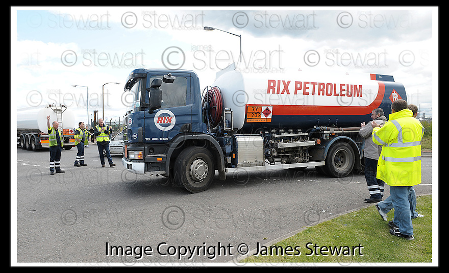 13/06/2008   Copyright Pic: James Stewart.File Name : sct_16_grangemouth.A TANKER DRIVER TURNS AWAY AFTER REFUSING TO CROSS THE PICKET LINE OF STRIKING SHELL DRIVERS IN GRANGEMOUTH....James Stewart Photo Agency 19 Carronlea Drive, Falkirk. FK2 8DN      Vat Reg No. 607 6932 25.Studio      : +44 (0)1324 611191 .Mobile      : +44 (0)7721 416997.E-mail  :  jim@jspa.co.uk.If you require further information then contact Jim Stewart on any of the numbers above........